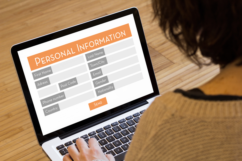filling out personal information on laptop